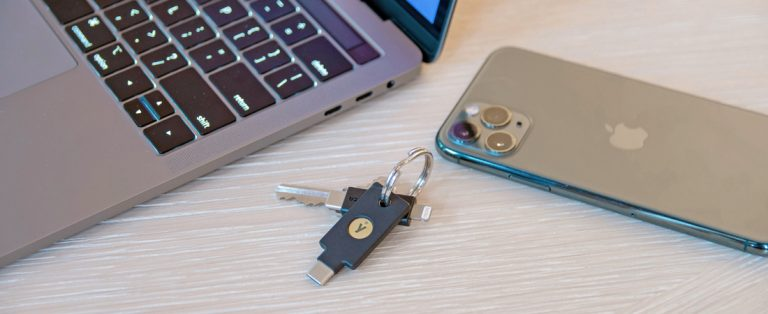 laptop, YubiKey 5C NFC, cell phone