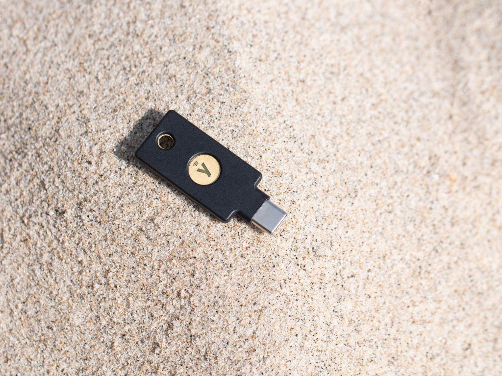 YubiKey 5C NFC on top of sand