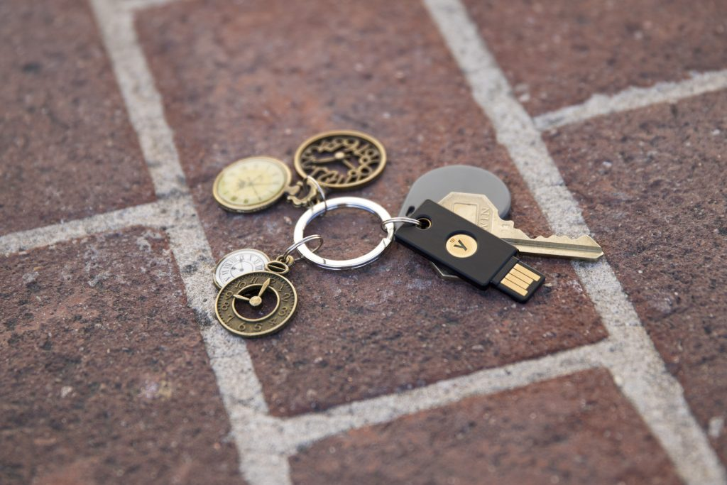 YubiKey on a key chain with various keys and decorative keychains