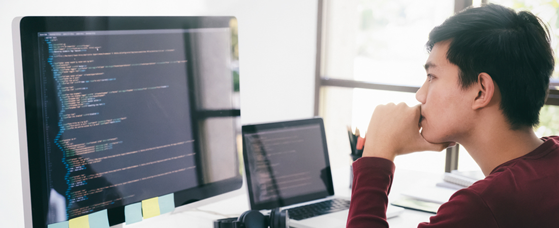 Person sitting at desk in front of computer screen