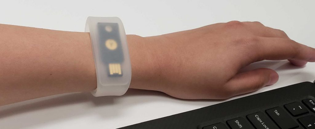 pocketband with YubiKey 5 NFC on person's wrist