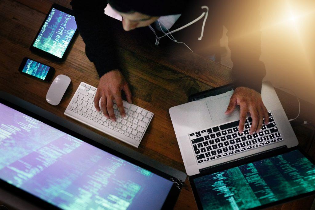 hacker using multiple machines