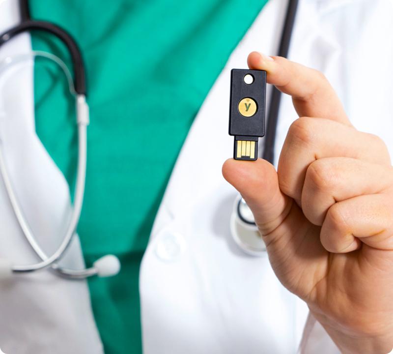 medical professional holding a yubikey