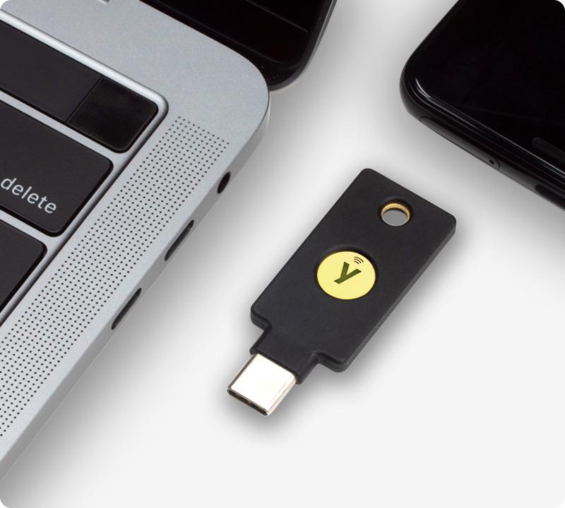 YubiKey 5C NFC next to laptop